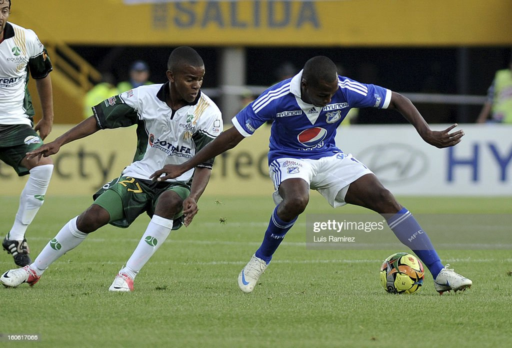 Dhawling Leudo (R) of Millonarios struggles for the ball with Darwin Andrade (L) of Equidad during a match between Millonarios and Equidad as part of the Liga Postobon 2013 at Nemesio Camacho Stadium on February 03, 2013 in Bogota, Colombia.