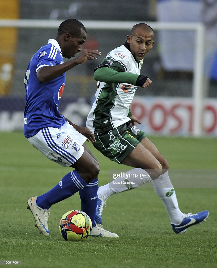 Dhawling Leudo (L) of Millonarios struggles for the ball with Ivan Corredor (R) of Equidad during a match between Millonarios and Equidad as part of the Liga Postobon 2013 at Nemesio Camacho Stadium on February 03, 2013 in Bogota, Colombia.