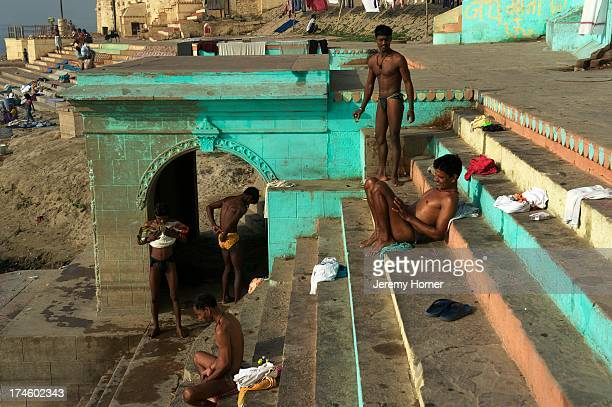 Dhobis on Lal Ghat in Varanasi As dawn breaks over the sacred Ganges River the Ghats of the ancient city are the scene of prayer exercise laundry and...