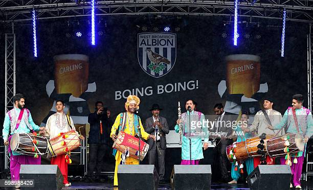 Dhol Blasters entertain the fans in the West Bromwich Albion FanZone prior to the international friendly match between West Bromwich Albion and Delhi...