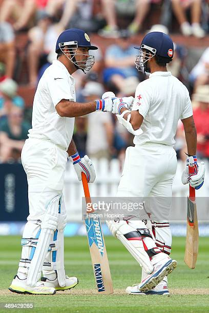Dhoni and Ajinkya Rahane of India talk in between overs during day two of the 2nd Test match between New Zealand and India on February 15 2014 in...