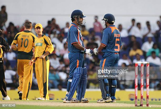 Dhoni and Gautam Gambhir of India talk during the Second One Day International match between India and Australia at the Vidarbha Cricket Association...