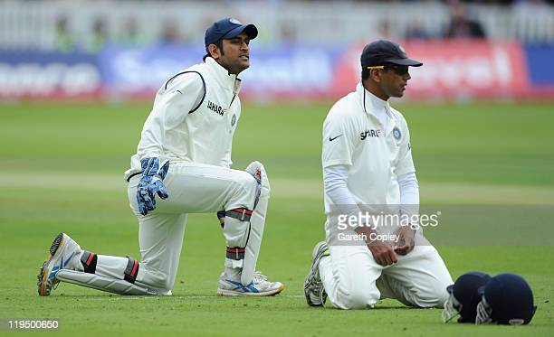 Dhoni and Rahul Dravid react after dropping Jonathan Trott of England during the first npower test match between England and India at Lord's Cricket...