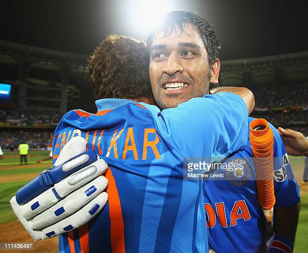 Dhoni and Sachin Tendulkar of India celebrate their teams win during the 2011 ICC World Cup Final between India and Sri Lanka at the Wankhede Stadium...