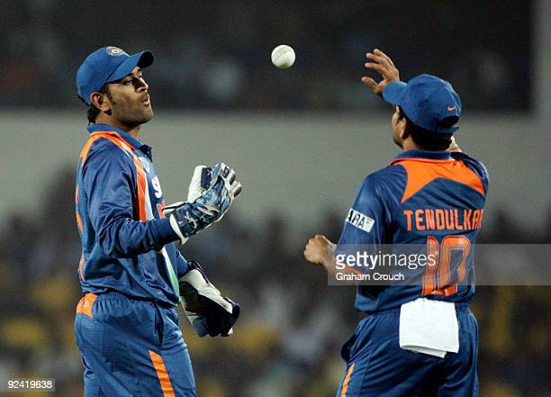 Dhoni and Sachin Tendulkar of India in action during the Second One Day International match between India and Australia at the Vidarbha Cricket...