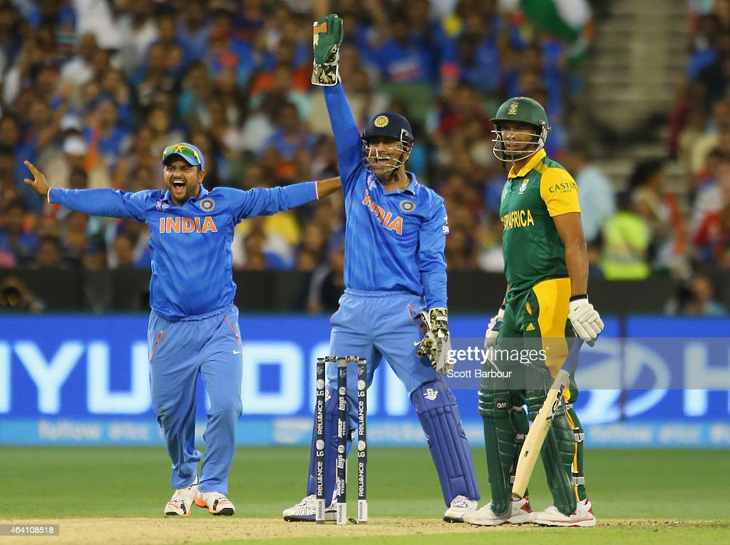 MS Dhoni (C) and <a gi-track='captionPersonalityLinkClicked' href=/galleries/search?phrase=Suresh+Raina&family=editorial&specificpeople=542210 ng-click='$event.stopPropagation()'>Suresh Raina</a> (L) of India appeal successfully to dismiss <a gi-track='captionPersonalityLinkClicked' href=/galleries/search?phrase=Vernon+Philander&family=editorial&specificpeople=4353155 ng-click='$event.stopPropagation()'>Vernon Philander</a> of South Africa during the 2015 ICC Cricket World Cup match between South Africa and India at Melbourne Cricket Ground on February 22, 2015 in Melbourne, Australia.
