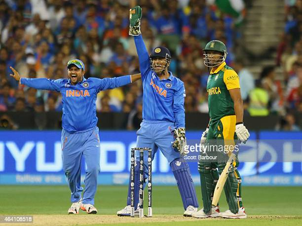 Dhoni and Suresh Raina of India appeal successfully to dismiss Vernon Philander of South Africa during the 2015 ICC Cricket World Cup match between...