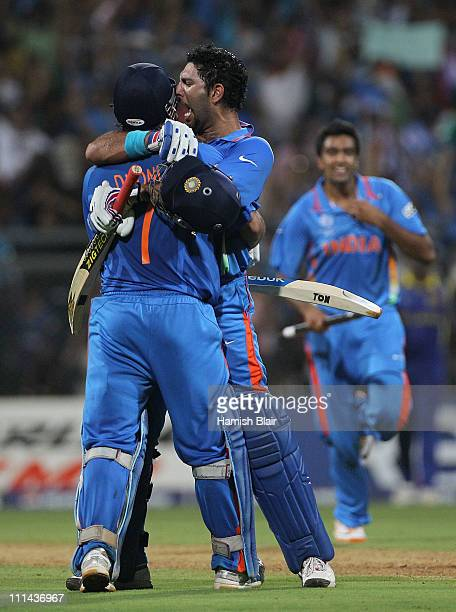 Dhoni and Yuvraj Singh of India celebrate after Dhoni hit a six to win the match during the 2011 ICC World Cup Final between India and Sri Lanka at...