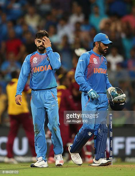 Dhoni Captain of India and Virat Kohli looks on dejected after loosing narrowly during the ICC World Twenty20 India 2016 SemiFinal match between West...