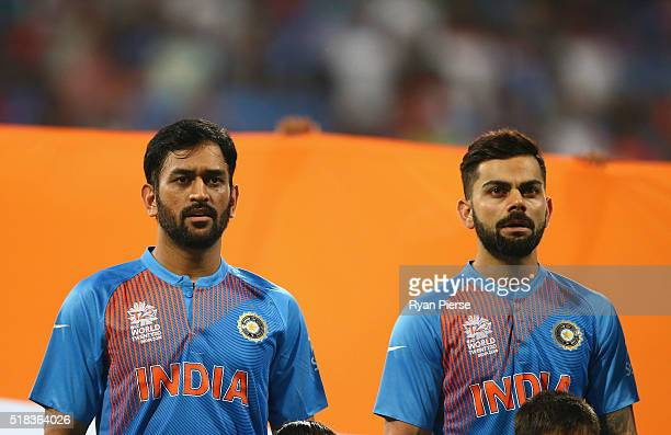Dhoni Captain of India and Virat Kohli of India looks on during the ICC World Twenty20 India 2016 Semi Final match between West Indies and India at...