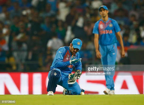 Dhoni Captain of India seems to pick up an injury to his fingers during the ICC World Twenty20 India 2016 Group 2 match between New Zealand and India...