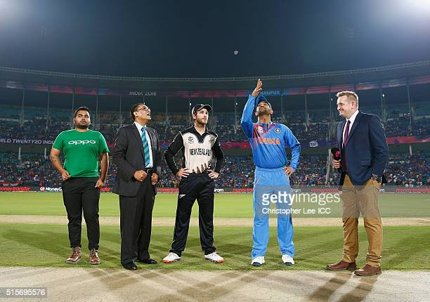 Dhoni Captain of India tosses the coin with Kane Williamson Captain of New Zealand during the ICC World Twenty20 India 2016 Group 2 match between New...