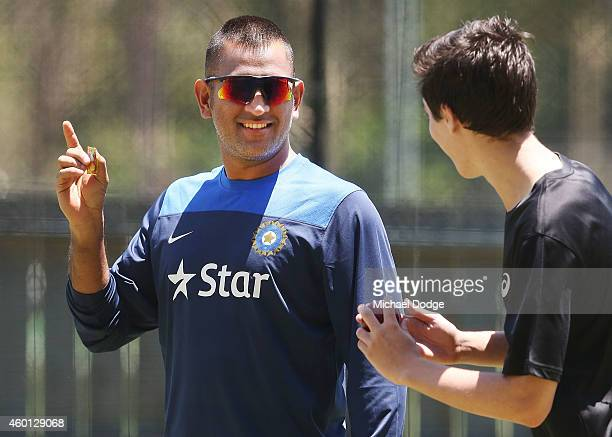 Dhoni gestures to a young bowler in the nets during an India Training Session at Adelaide Oval on December 8 2014 in Adelaide Australia Dhoni was...