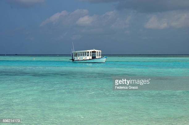 Dhoni (traditional boat) in Maldivian Lagoon