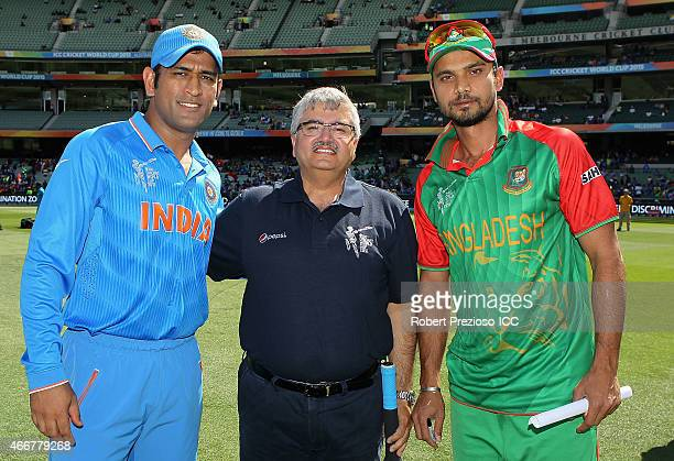 Dhoni of India and Mashrafe Mortaza of Bangladesh pose with a competition winner after the coin toss during the 2015 ICC Cricket World Cup match...