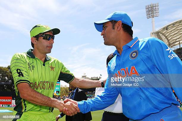 Dhoni of India and Shahid Afridi of Pakistan shake hands after the toss during the 2015 ICC Cricket World Cup match between India and Pakistan at...