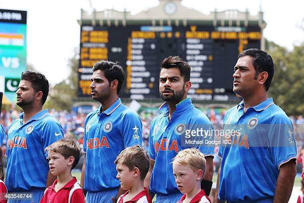 Dhoni of India and Virat Kohli of India stand for their national anthem during the 2015 ICC Cricket World Cup match between India and Pakistan at...