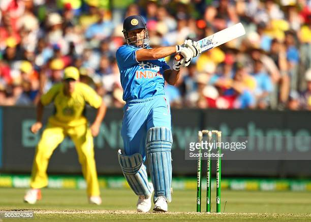 Dhoni of India bats during game three of the One Day International Series between Australia and India at the Melbourne Cricket Ground on January 17...