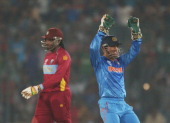 Dhoni of India celebrates after running out Chris Gayle of the West Indies during the ICC World Twenty20 Bangladesh 2014 match between the West...