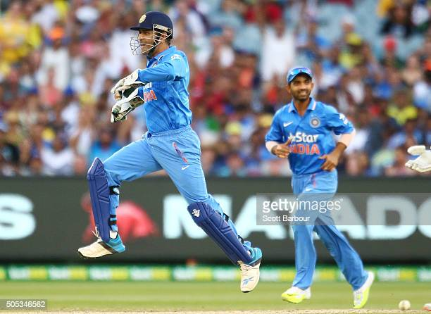 Dhoni of India celebrates after stumping George Bailey of Australia during game three of the One Day International Series between Australia and India...