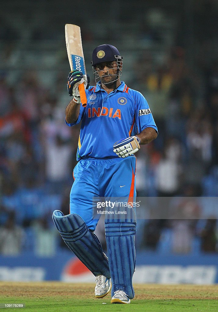 MS Dhoni of India celebrates his century during the 2011 ICC World Cup Warm up game against India and New Zealand at the MA Chidambaram Stadium on February 16, 2011 in Chennai, India.