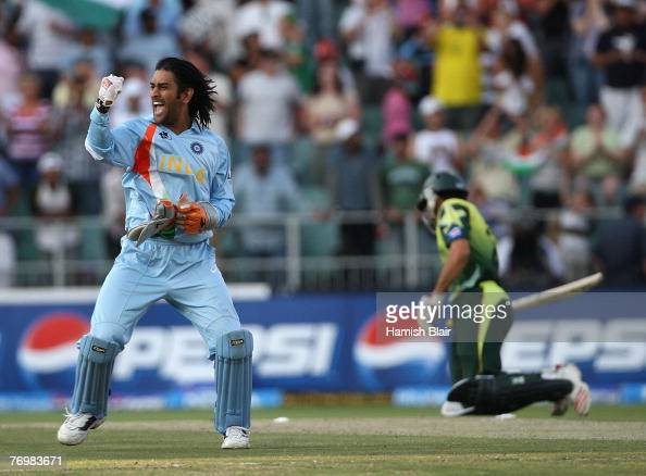 Dhoni of India celebrates his team's victory with MisbahulHaq of Pakistan looking on during the Twenty20 Championship Final match between Pakistan...