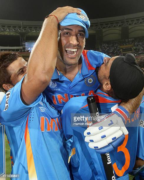 Dhoni of India celebrates victory with team mates Suresh Raina and Harnhajan Singh after the 2011 ICC World Cup Final between India and Sri Lanka at...