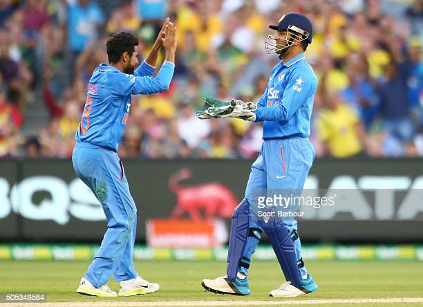 Dhoni of India celebrates with bowler Ravindra Jadeja after stumping George Bailey of Australia during game three of the One Day International Series...