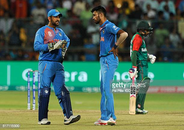 M S Dhoni of India has a word with Hardik Pandya of India as the latter gets ready to bowl the last over during the ICC World Twenty20 India 2016...