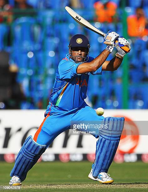 Dhoni of India hits the ball towards the boundary during the 2011 ICC World Cup Warm up game between India and Australia at the M Chinnaswamy Stadium...