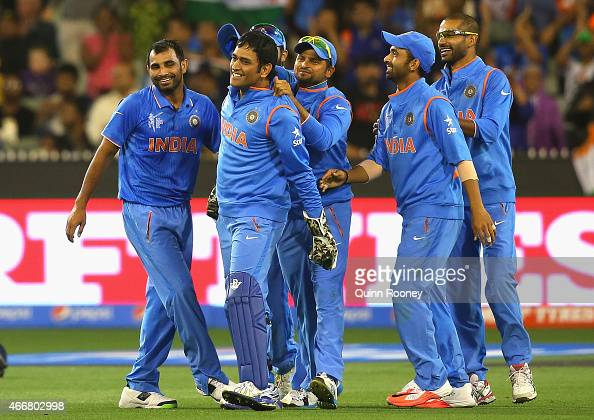 Dhoni of India is congratulated by team mates after getting the wicket of Soumya Sarkar of Bangladesh during the 2015 ICC Cricket World Cup Quater...