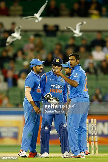 Dhoni of India is congratulated by team mates after stumping George Bailey of Australia during the One Day International match between Australia and...