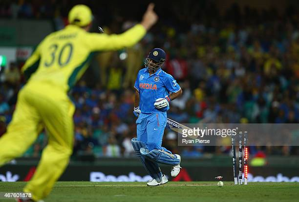 Dhoni of India is run out by Glenn Maxwell of Australia during the 2015 Cricket World Cup Semi Final match between Australia and India at Sydney...