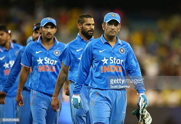 Dhoni of India leads his side from the field after they lost game three of the One Day International Series between Australia and India at the...