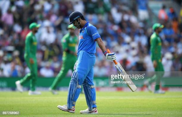 Dhoni of India leaves the field after being caught out by Imad Wasim of Pakistan during the ICC Champions Trophy Final between India and Pakistan at...