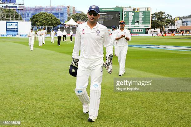 Dhoni of India leaves the field for lunch during day one of the 2nd Test match between New Zealand and India on February 14 2014 in Wellington New...