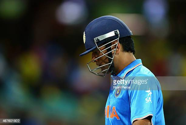 Dhoni of India leaves the ground after being run out by Glenn Maxwell of Australia during the 2015 Cricket World Cup Semi Final match between...