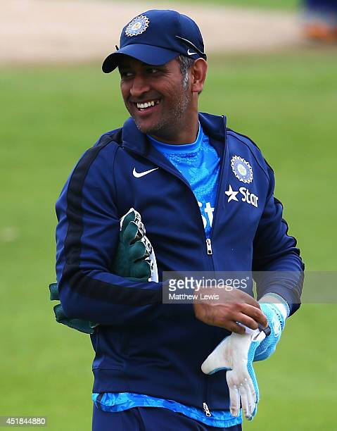 Dhoni of India looks on during a India nets session ahead of the first Investec Test Series at Trent Bridge on July 8 2014 in Nottingham England