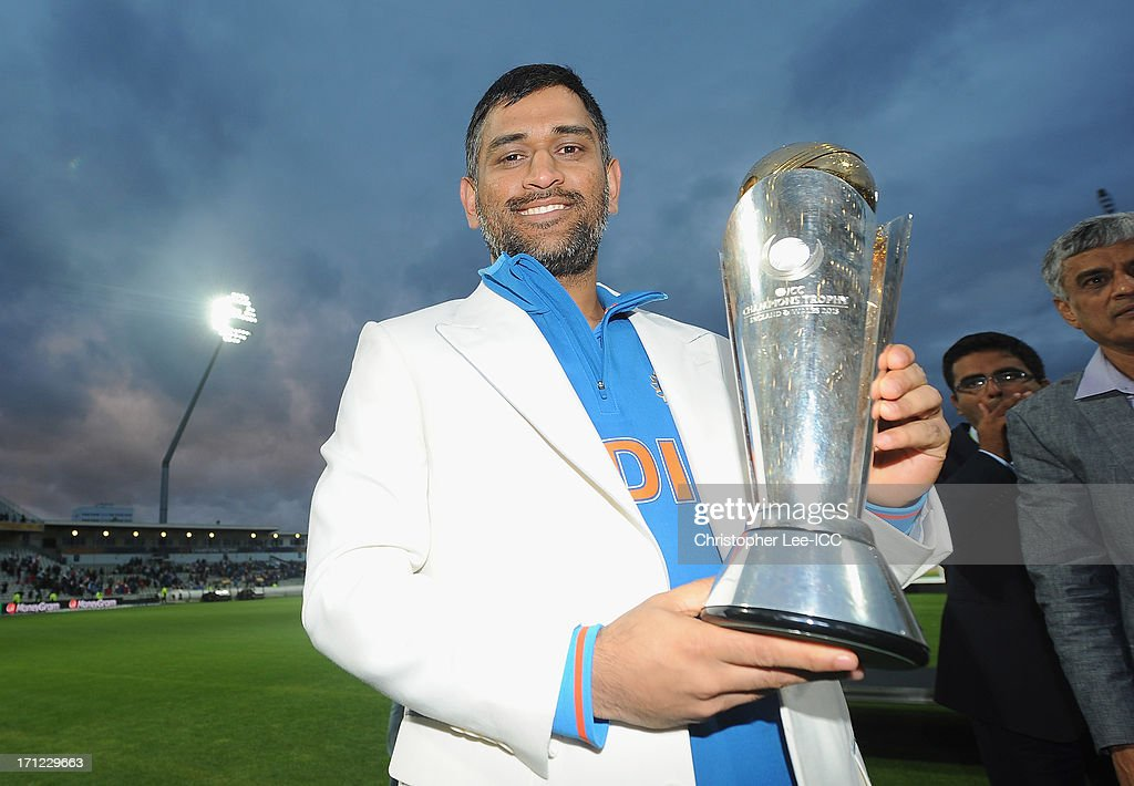 MS Dhoni of India poses with the Champions Trophy after their victory after the ICC Champions Trophy Final match between England and India at Edgbaston on June 23, 2013 in Birmingham, England.