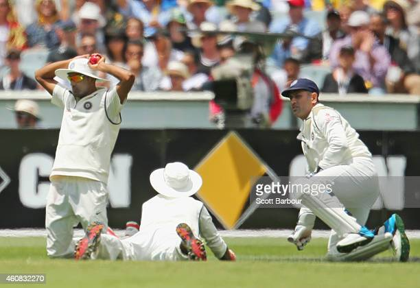 Dhoni of India reacts as Shikhar Dhawan of India drops a catch in the slips from Shane Watson of Australia during day one of the Third Test match...
