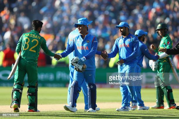 Dhoni of India shakes hands with Hasan Ali of Pakistan after his sides 124 run victory on the D/L Method during the ICC Champions Trophy match...
