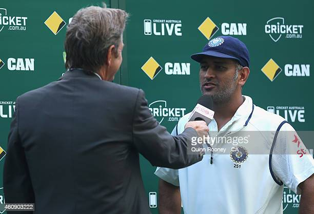 Dhoni of India speaks to Mark Nicholas after the game during day five of the Third Test match between Australia and India at Melbourne Cricket Ground...