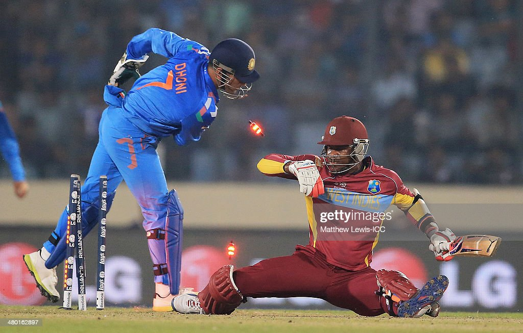 MS Dhoni of India stumps <a gi-track='captionPersonalityLinkClicked' href=/galleries/search?phrase=Marlon+Samuels&family=editorial&specificpeople=185235 ng-click='$event.stopPropagation()'>Marlon Samuels</a> of the West Indies off the bowling of Amith Mishra during the ICC World Twenty20 Bangladesh 2014 match between West Indies and India at Sher-e-Bangla Mirpur Stadium on March 23, 2014 in Dhaka, Bangladesh.