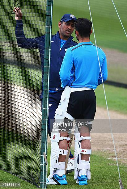 Dhoni of India talks to Virat Kohli during a India nets session ahead of the first Investec Test Series at Trent Bridge on July 8 2014 in Nottingham...