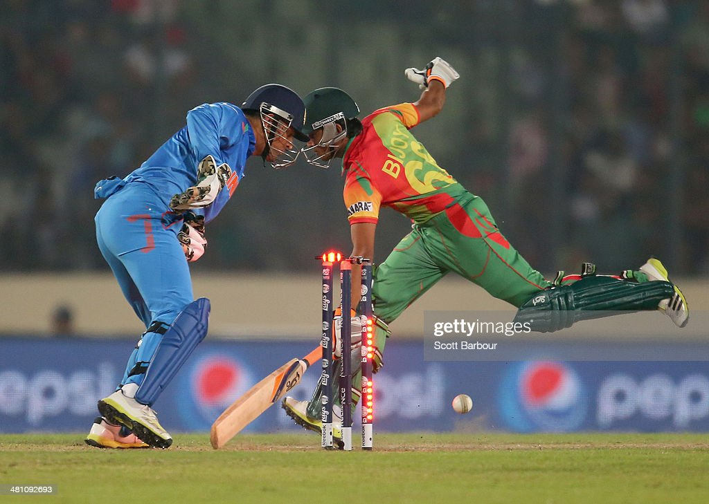 MS Dhoni of India unsuccessfully attempts to run out Anamul Haque of Bangladesh during the ICC World Twenty20 Bangladesh 2014 match between Bangladesh and India at Sher-e-Bangla Mirpur Stadium on March 28, 2014 in Dhaka, Bangladesh.