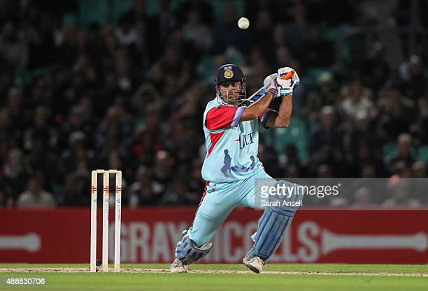 Dhoni of the Help for Heroes team hits a boundary during the Cricket for Heroes charity match at The Kia Oval on September 17 2015 in London England