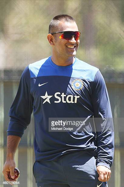 Dhoni reacts in the nets during an India Training Session at Adelaide Oval on December 8 2014 in Adelaide Australia Dhoni was earlier announced at a...