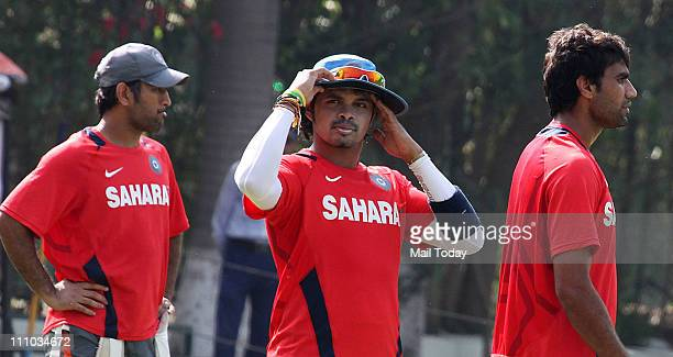 Dhoni Sreesanth and Munaf Patel during a training session at The Punjab Cricket Association Stadium in Mohali on March 28 2011 India will face...