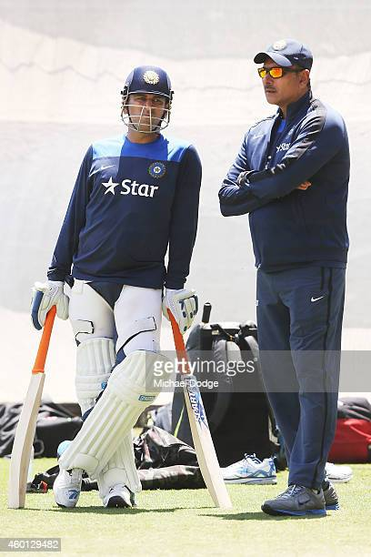 Dhoni talks to India Director of Cricket Ravi Shastri during an India Training Session at Adelaide Oval on December 8 2014 in Adelaide Australia...