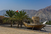 In the musandam in Oman. Dhow in front of khasab fort, Oman